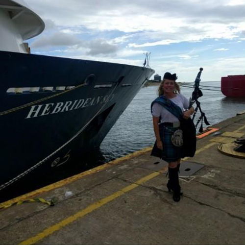 bow of a ship with a piper